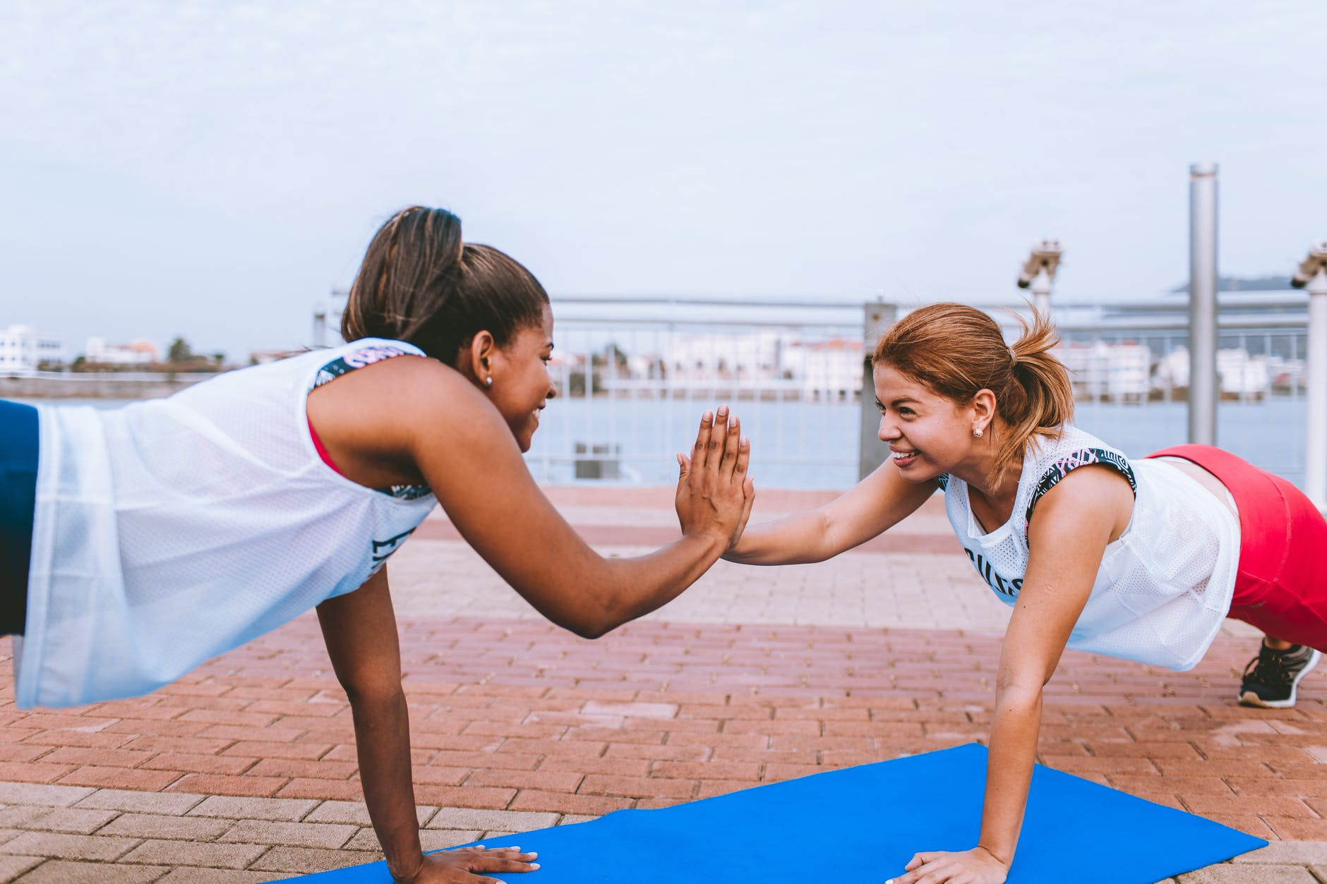 two woman doing exercise and having a fun workout